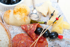 Mix cold cut on a stone with fresh pears Stock Photography