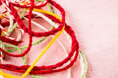 Mix color mulberry paper rope. On pink mulberry paper Royalty Free Stock Images