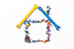 Mix of color nuts and bolts. On white background Stock Photos