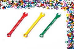 Mix of color nuts and bolts. On white background Stock Photo