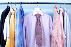 Mix color Shirt and Tie on Hangers Royalty Free Stock Photography
