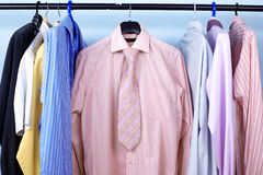 Mix color Shirt and Tie on Hangers Stock Image