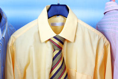 Mix color Shirt and Tie on Hangers Stock Photography