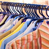 Mix color Shirt and Tie on Hangers Stock Images