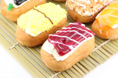 Mix color Sushi Donuts in bamboo dish. Closeup Mix color Sushi Donuts in bamboo dish on white background royalty free stock images