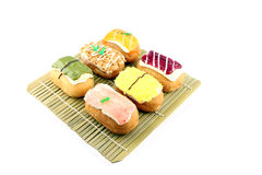 Mix color Sushi Donuts in bamboo dish. Mix color Sushi Donuts in bamboo dish on white background royalty free stock photography