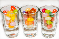 A mix of colored jelly beans candy in shot glasses. Royalty Free Stock Photo
