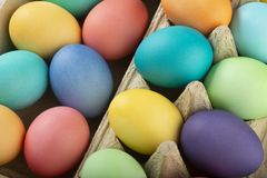 Mix of colorful chicken eggs in a box royalty free stock photos