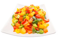 Mix Colorful Chopped Capsicums In White Plate VIII Stock Photography