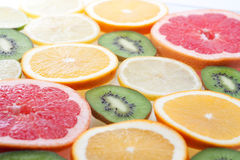 Mix of colorful citrus fruit on white. Background Royalty Free Stock Photos