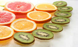 Mix of colorful citrus fruit on white Royalty Free Stock Photos