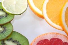Mix of colorful citrus fruit on white. Background Royalty Free Stock Photo