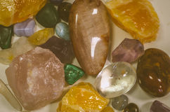Mix of colorful gem stones. Mixture of transparent, brown, pink and yellow gem stones Stock Photos