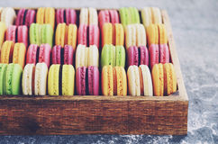 Mix of colorful macaroons with copy space on grey background Royalty Free Stock Photos