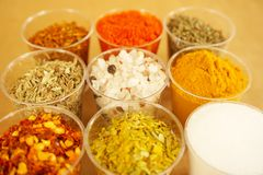 Mix of colorful Mediterranean dried spices with salt and paper in the middle stock photos
