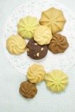 The mix cookies. The different variaty of cookies on the white cake sheet and pale blue background Stock Photography