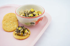 Mix corn, oats, chocolate and sweetened condensed milk put on cracker. Mix corn, oats and sweetened condensed milk put on cracker sprinkle with chocolate placed Stock Photo
