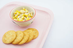 Mix corn, oats and sweetened condensed milk on pink tray Stock Images