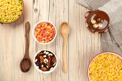 Mix cornflakes and dried fruits on wooden background Stock Photos