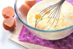 Mix of cream, melt white chocolate and eggs Stock Images