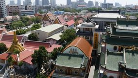 Mix of cultures on city street. Wonderful view of traditional Chinese and Thai temples on sunny day on street of Bangkok. City downtown panorama stock video footage
