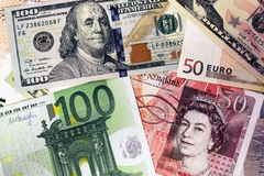 Mix of currencies banknotes - Dollar, Pound Sterling, Euro. Money Stock Photo