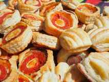 Mix of delicious appetizers and small pizzas made of puff pastry royalty free stock images