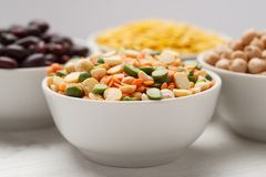 Mix of different beans in ceramic bowl, macro.  royalty free stock image