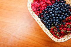 Mix of different berries. In basket Royalty Free Stock Images