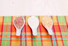 Mix of different cereals on the board dietetic food Royalty Free Stock Images