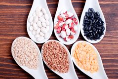Mix of different cereals on the board dietetic food Stock Photo