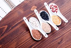 Mix of different cereals on the board dietetic food Royalty Free Stock Photography