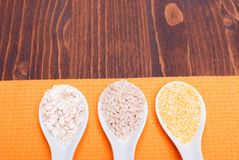 Mix of different cereals on the board dietetic food Royalty Free Stock Image