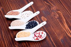 Mix of different cereals on the board dietetic food Stock Photos