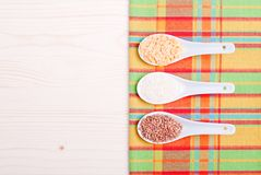 Mix of different cereals on the board dietetic food Royalty Free Stock Photo