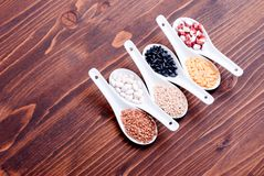 Mix of different cereals on the board dietetic food Royalty Free Stock Photos