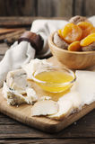 Mix of different cheese with honey Stock Image