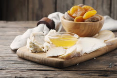 Mix of different cheese with honey Stock Photo