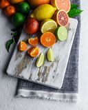 Mix of different citrus fruits closeup royalty free stock photos