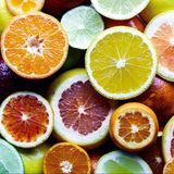 Mix of different citrus fruits closeup royalty free stock photo