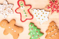 Mix of different form Gingerbread cookies with icing on a light. Wooden background, green fir tree, ginger man,star,christmas tree stock images