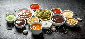 Mix from different kinds of sauces. On dark rustic background stock image