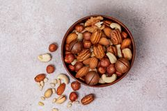 Mix of different nuts. Mix of nuts in a wooden bowl on a light background. view from above royalty free stock photos