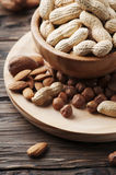 Mix of different nuts on the wooden table Royalty Free Stock Images