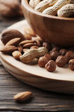 Mix of different nuts on the wooden table Stock Images
