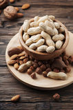 Mix of different nuts on the wooden table Royalty Free Stock Photo