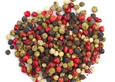 Mixture pepper in on white background. Mix of different peppers, mixture of hot pepper, red pepper, black pepper, white pepper, green pepper Isolated on white Royalty Free Stock Images