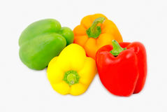 A mix of differently colored bell peppers isolated on white back Stock Images
