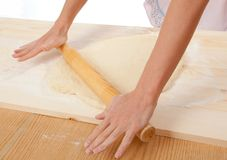 Mix dough on the wooden board . Royalty Free Stock Photo