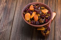 Mix of dried fruit. In clay bowl. healthy food background Stock Photography